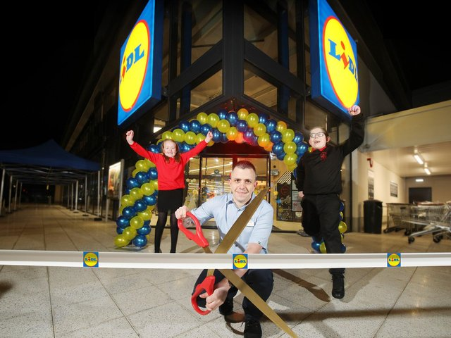 Pictured at the store opening are Lily Irvine (Edenbrooke Primary School), Thomas McFarlane (Lidl Northern Ireland Hillview Retail Park Store Manager) and Pearse Osborne (Holy Cross Boys Primary)