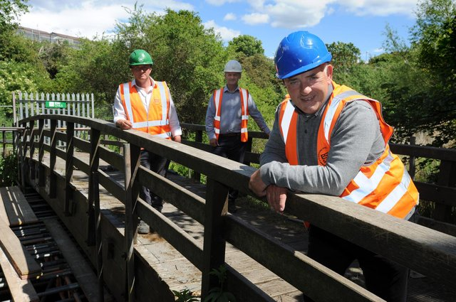 South Tyneside Council Cllr Ernest Gibson with ESH Civils contract manager Stephen McClean and project manager Steve Marshall, at the damaged Mill Dene footbridge over the River Don which is to be replaced.