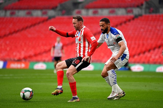 Aiden McGeady of Sunderland battles for possession with Liam Feeney of Tranmere Rovers during the Papa John's Trophy final match.