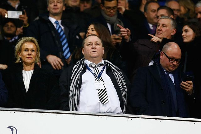 Newcastle United owner Mike Ashley (C), Linda Ashley (L) and managing director Lee Charnley (R) look on from the stand prior to the Barclays Premier League match between Tottenham Hotspur and Newcastle United at White Hart Lane on December 13, 2015 in London, England.