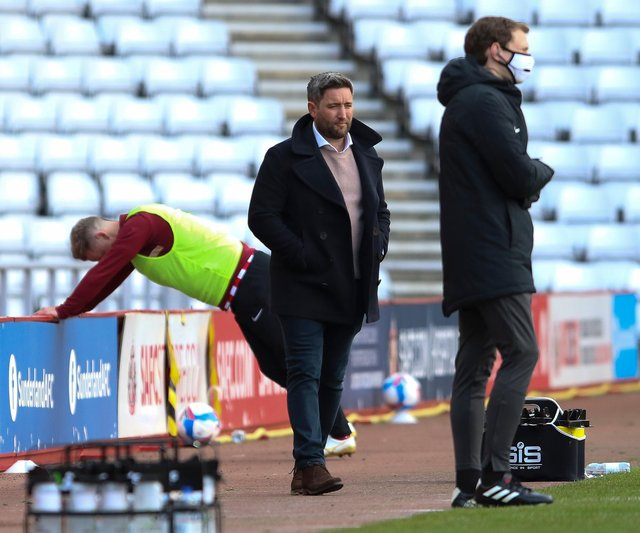 Lee Johnson watches on as his side draw 3-3 with Accrington Stanley