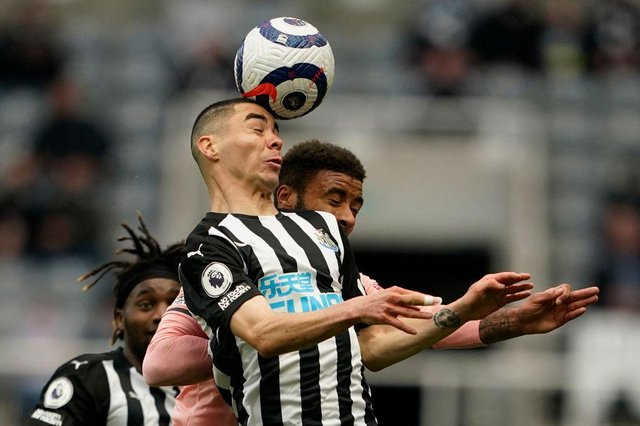 Newcastle United's Paraguayan midfielder Miguel Almiron (C) vies with Sheffield United's English defender Jayden Bogle (R) during the English Premier League football match between Newcastle United and Sheffield United at St James' Park in Newcastle-upon-Tyne, north east England on May 19, 2021.