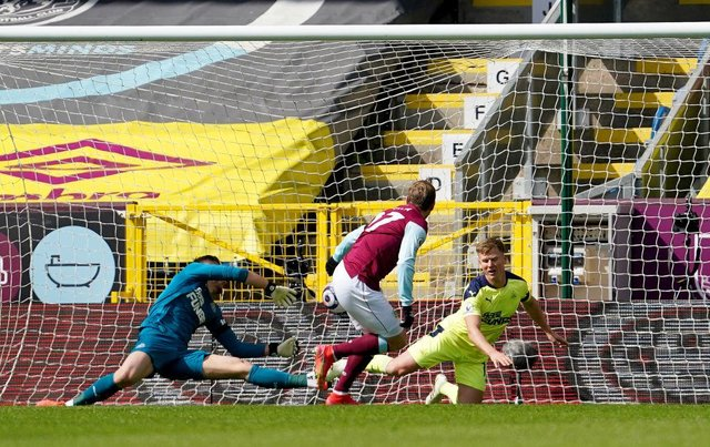 Matej Vydra of Burnley scores their team's first goal past Martin Dubravka and Matt Ritchie of Newcastle United during the Premier League match between Burnley and Newcastle United at Turf Moor on April 11, 2021 in Burnley, England.