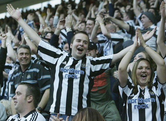 Newcastle United fans celebrate their first goal during the FA Barclaycard Premiership match between Southampton and Newcastle United at St. Mary's Stadium.