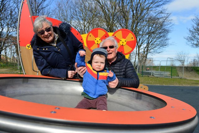 Family fun at the new North Marine Play Park. Great grandparents Jimmy and Lana Flannery with Gruffydd Morris-Campbell, one.