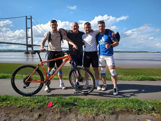 The four lads at Humber Bridge during the challenge