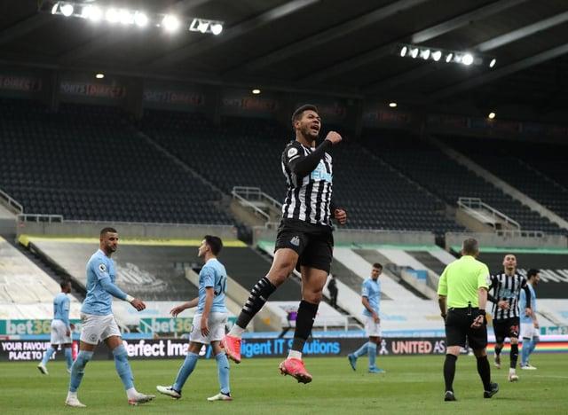 Joelinton celebrates scoring his penalty.
