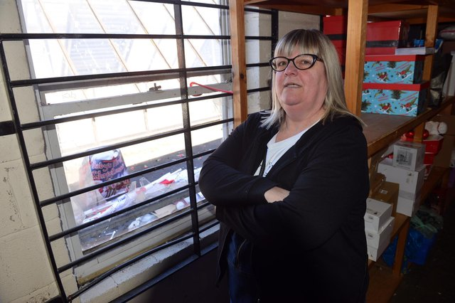 Cardstation employee Diane Hatch in the upstairs stock room of the shop, which has had two of its windows smashed in the early hours of the morning.