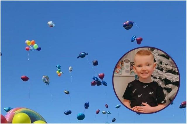 The loved ones of little Robbie Elliott have released ballloons in his memory.