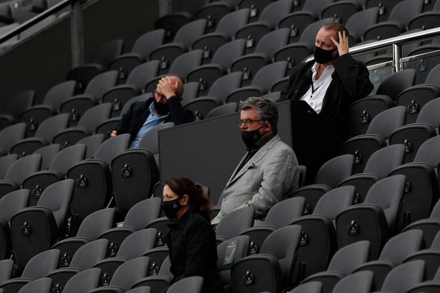 Newcastle United's English owner Mike Ashley (R) watches his side lose the English Premier League football match between Newcastle United and Brighton and Hove Albion at St James' Park in Newcastle upon Tyne, north-east England on September 20, 2020.