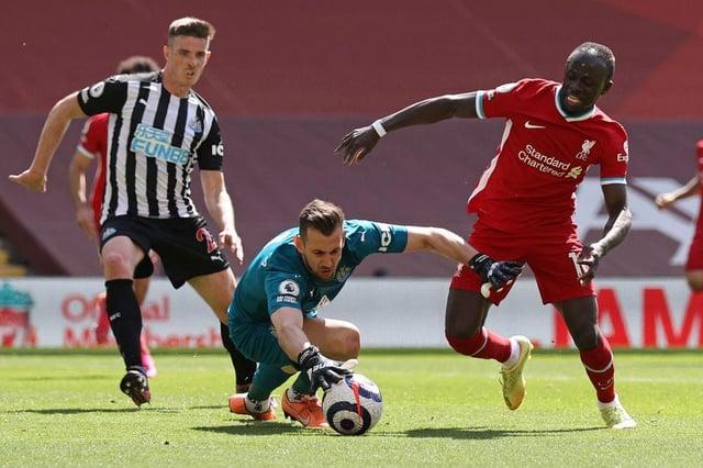 Martin Dubravka takes the ball from the feet of Sadio Mane.