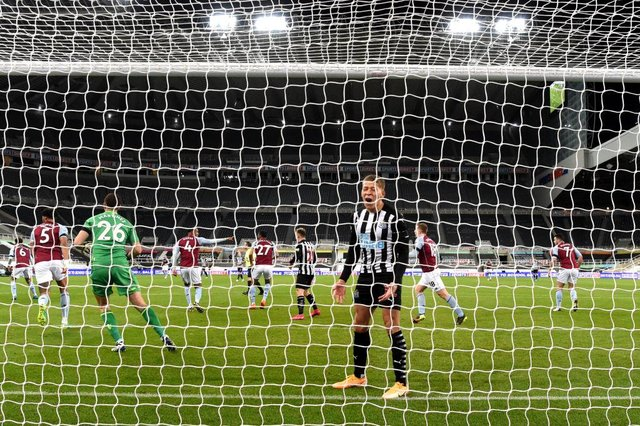 Dwight Gayle of Newcastle United reacts during the Premier League match between Newcastle United and Aston Villa at St. James Park on March 12, 2021 in Newcastle upon Tyne, England.