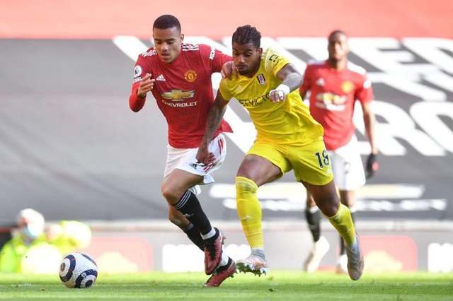 Fulham's Gabonese midfielder Mario Lemina (R) vies for the ball against Manchester United's English striker Mason Greenwood (L) during the English Premier League football match between Manchester United and Fulham at Old Trafford in Manchester, north west England, on May 18, 2021.