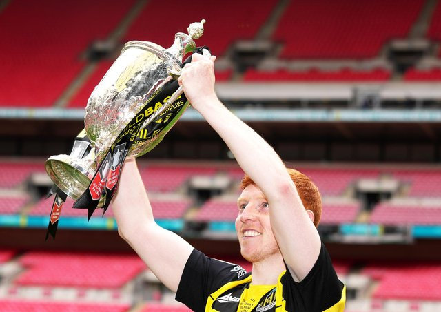 Hebburn Town's Michael Richardson celebrates with lifting the Buildbase FA Vase 2019/20 Trophy after victory in the Final at Wembley Stadium, London. PA picture.