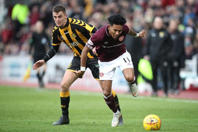 Demetri Mitchell in action for Hearts.