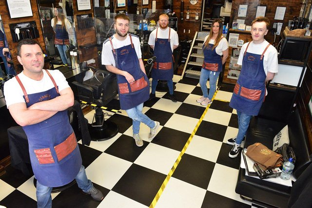 From left to right, Andrew Appleton, Liam Grant, Scott Drew, Lesley-Anne Round and Ryan Bartlett are ready to reopen at Stoney's Barber Shop.