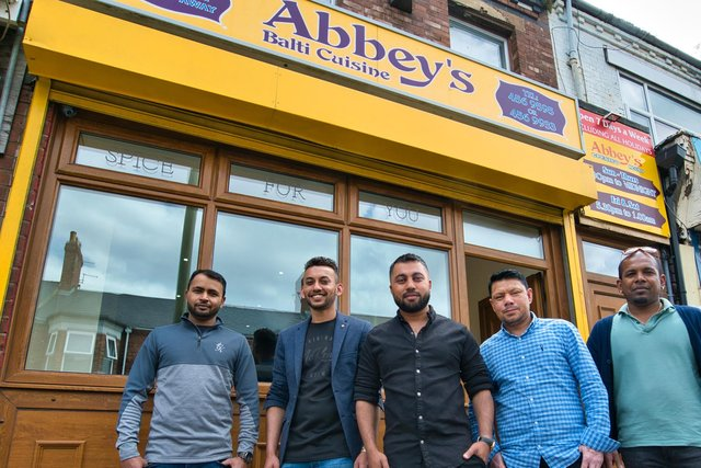 Owner of Abbey's South Shields, Rubel Jamal - center, with chefs from the takeaway.
