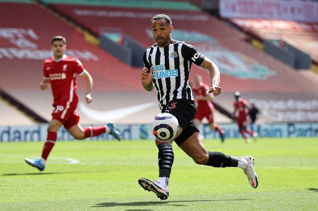 Callum Wilson of Newcastle United looks to control the ball during the Premier League match between Liverpool and Newcastle United at Anfield on April 24, 2021 in Liverpool, England.