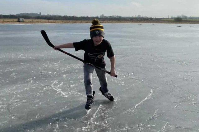 Eight-year-old Oliver Payette enjoys surprise holiday outing on the ice, after months of ice hockey practice cancellations