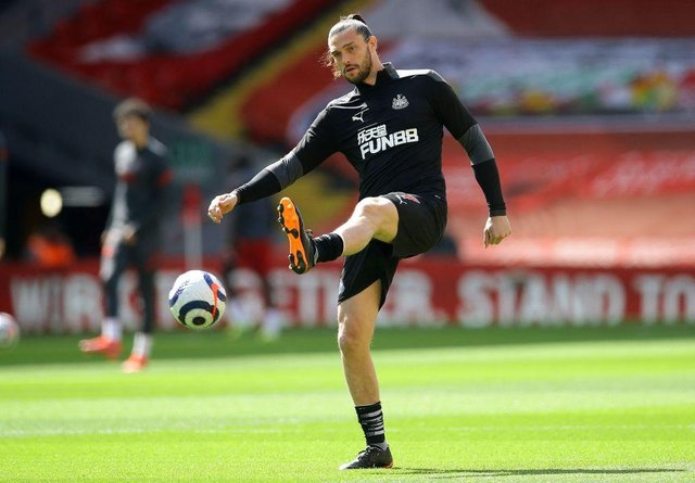 Newcastle United's English striker Andy Carroll warms up ahead of the English Premier League football match between Liverpool and Newcastle United at Anfield in Liverpool, north west England on April 24, 2021.