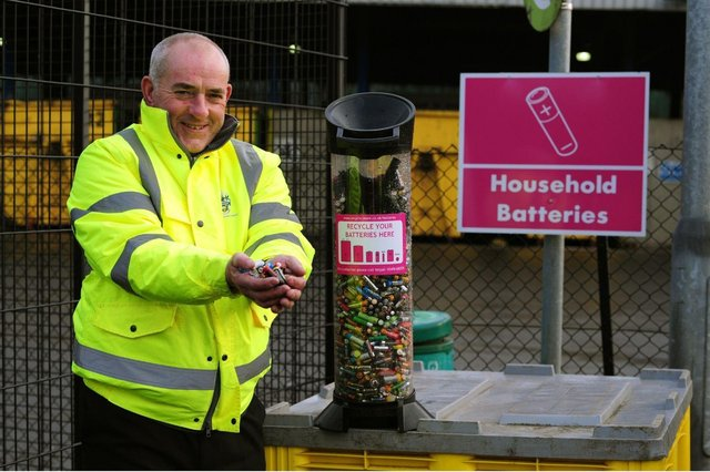 Cllr Ernest Gibson disposing of batteries at Middlefields. Picture taken before the current stay-at-home order was in place
