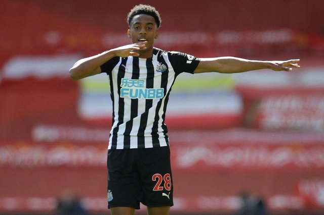 Newcastle United's English midfielder Joe Willock celebrates after scoring the equalising goal during the English Premier League football match between Liverpool and Newcastle United at Anfield in Liverpool, north west England on April 24, 2021.