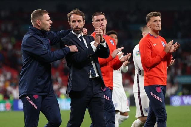 Graeme Jones consoles Gareth Southgate after England's final defeat.