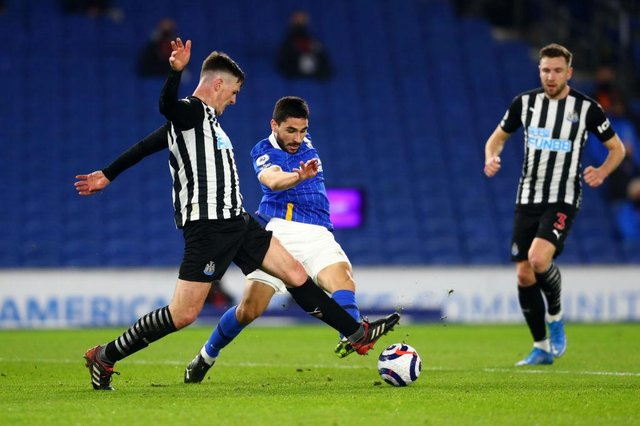 Neal Maupay of Brighton & Hove Albion is challenged by Ciaran Clark of Newcastle United during the Premier League match between Brighton & Hove Albion and Newcastle.