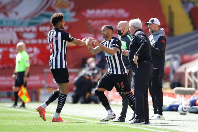 Callum Wilson of Newcastle United comes on for Joelinton of Newcastle United during the Premier League match between Liverpool and Newcastle United at Anfield on April 24, 2021 in Liverpool, England.
