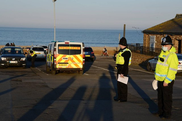Police officers stop to issue compliance letters to motorists travelling from afar to South Shields seaside, in South Tyneside over the weekend