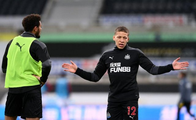 Newcastle United's English striker Dwight Gayle (R) gestures while talking with Newcastle United's Brazilian striker Joelinton (L) ahead of the kickoff during the English Premier League football match between Newcastle United and Aston Villa at St James' Park in Newcastle-upon-Tyne, north east England on March 12, 2021.