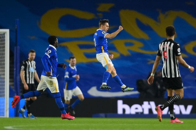 Leandro Trossard of Brighton & Hove Albion celebrates after scoring their team's first goal during the Premier League match between Brighton & Hove Albion and Newcastle United.