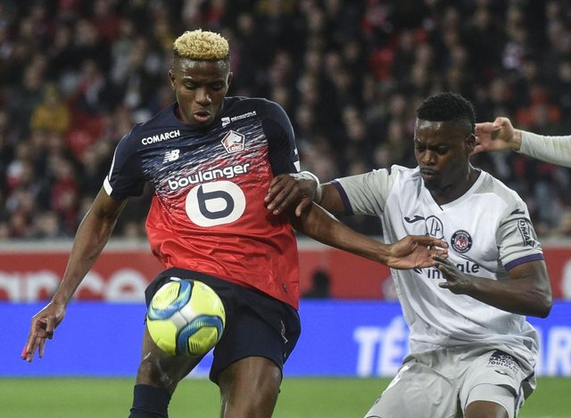 Lille's Nigerian forward Victor Osimhen (L) fights for the ball against Toulouse's Ivorian midfielder Ibrahim Sangare during the French L1 football match between Lille and Toulouse on February 22, 2020 at the Pierre Mauroy Stadium in Villeneuve d'Ascq. (Photo by FRANCOIS LO PRESTI / AFP) (Photo by FRANCOIS LO PRESTI/AFP via Getty Images)