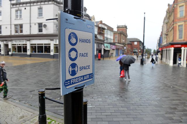 Covid warning signage in King Street, South Shields town centre.