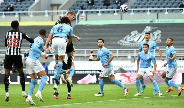 Newcastle United's Swedish defender Emil Krafth (4L) scores the opening goal during the English Premier League football match between Newcastle United and Manchester City at St James' Park in Newcastle-upon-Tyne, north east England on May 14, 2021.