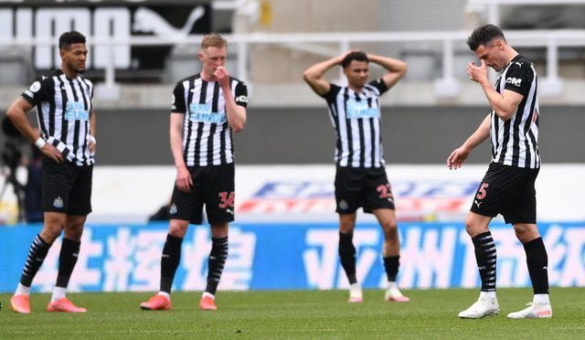 Newcastle United's Swiss defender Fabian Schar (R) walks off the pitch after being shown a red card during the English Premier League football match between Newcastle United and Arsenal at St James' Park in Newcastle-upon-Tyne, north east England on May 2, 2021.