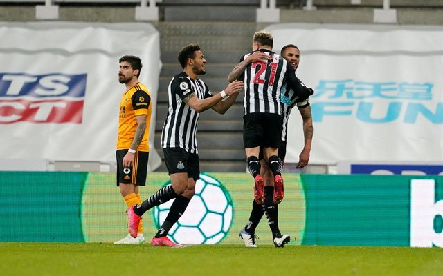 Jamaal Lascelles of Newcastle United celebrates with team mates Ryan Fraser and Joelinton after scoring their side's first goal during the Premier League match between Newcastle United and Wolverhampton Wanderers at St. James Park on February 27, 2021 in Newcastle upon Tyne, England.