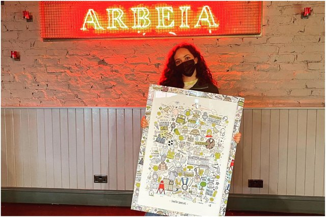 Jade Thirlwall in her home town bar Arbeia where the South Shields print by design company Lines Behind will go on display.