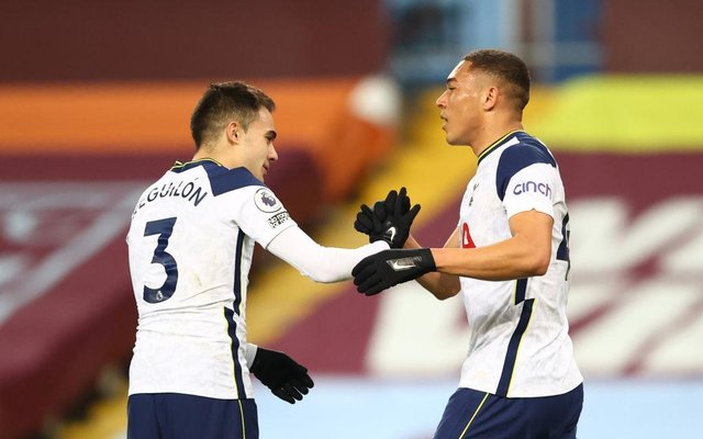 Carlos Vinicius of Tottenham Hotspur celebrates with Sergio Reguilon after scoring their side's first goal during the Premier League match between Aston Villa and Tottenham Hotspur at Villa Park on March 21, 2021 in Birmingham, England.
