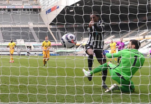 Joe Willock of Newcastle United scores their team's second goal past Hugo Lloris of Tottenham Hotspur.