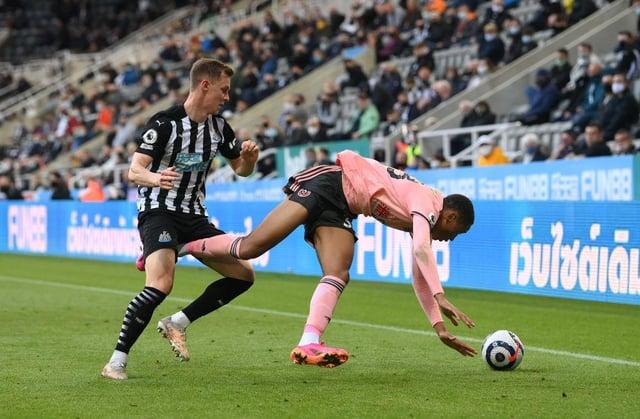 Sheffield United player Daniel Jebbison (r) is challenged by Emil Krafth.
