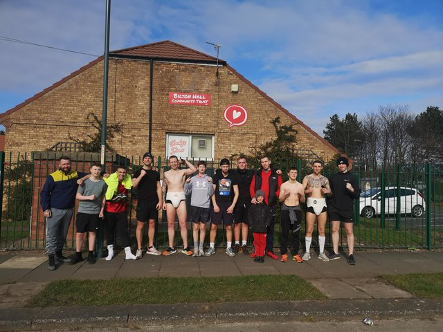 Members of the Bilton Hall ABC limbering up before the 48-mile challenge.