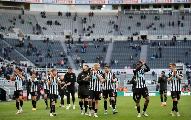 Newcastle United's players thank the fans after the English Premier League football match between Burnley and Liverpool at Turf Moor in Burnley, north west England on May 19, 2021. - Newcastle won the game 1-0.