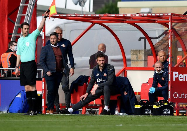 Lee Johnson watches on at the LNER Stadium as Sunderland fall to a 2-0 defeat