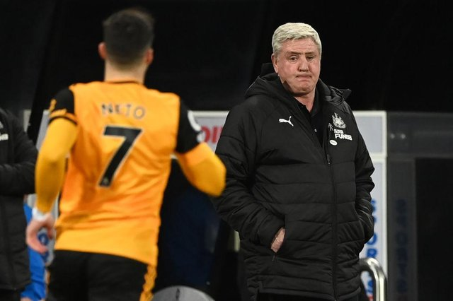 Newcastle United's English head coach Steve Bruce (R) looks on during the English Premier League football match between Newcastle United and Wolverhampton Wanderers at St James' Park in Newcastle-upon-Tyne, north east England on February 27, 2021.