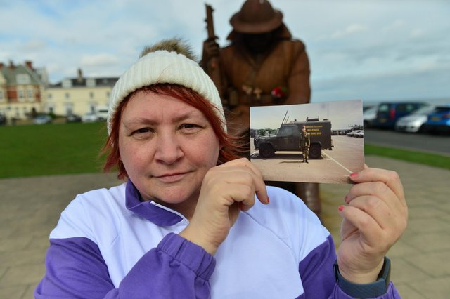 Denise Kidger with a photograph of her late brother Stephen Kidger from the 2nd Battalion, Royal Regiment of Fusiliers, photographed in Northern Ireland. Picture by Frank Reid.