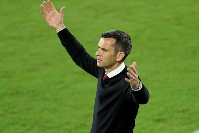 Head coach Stephen Glass of Atlanta United FC reacts during the CONCACAF Champions League quarterfinal game against Club America at Exploria Stadium on December 16, 2020 in Orlando, Florida.