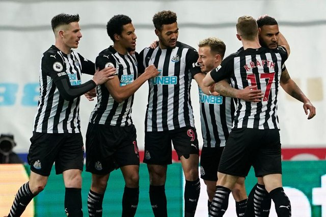 Newcastle United's English defender Jamaal Lascelles (R) celebrates with teammates after scoring the opening goal of the English Premier League football match between Newcastle United and Wolverhampton Wanderers at St James' Park in Newcastle-upon-Tyne, north east England on February 27, 2021.