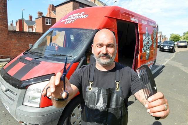 Ali Barber owner Ali Sezer with his new mobile barber van.