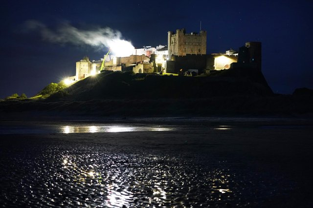 Smoke billows from Bamburgh Castle in Northumberland as filming for the new Indiana Jones 5 movie starring Harrison Ford takes place during the night. Picture date: Thursday June 10, 2021.
